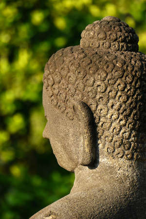 Close-up of the head of one of the many Buddha statues found at the ancient temple of Borobudur, Java, Indonesia Stock Photo