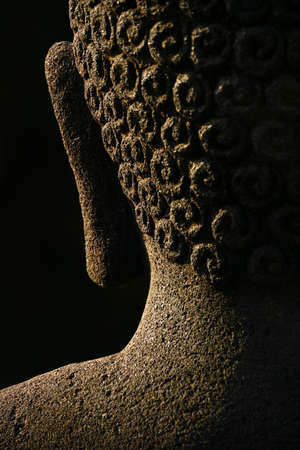 buddha tranquil: The back of a Buddha s head featuring an ear and hair details  This is an  an abstract of an authentic, ancient stone statue found in the Borobudur temple complex in Indonesia