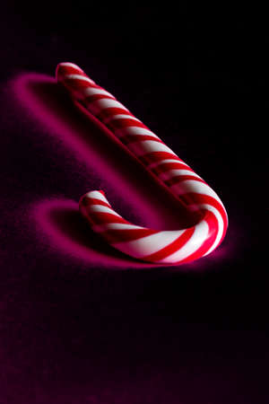 Christmas Stick of hard candy on the dark blured background