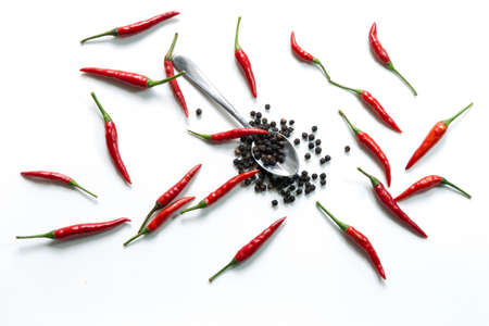 capsaicin: Fresh red hot thai chili and pepper in spoon on white background Stock Photo