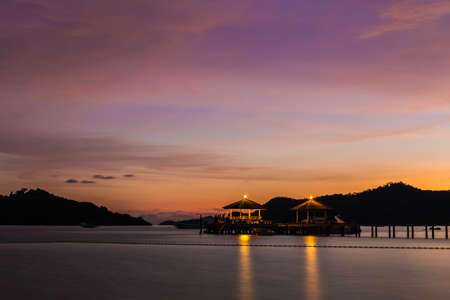 Wooded bridge in the port between sunset in seastern island of Thailand
