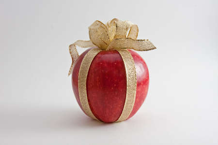 Shiny Red Apple Tied with God Mesh Ribbon photo