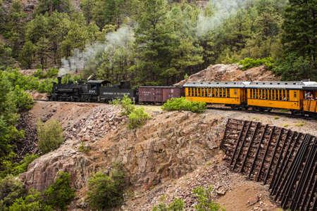 Durango-Silverton Narrow Gauge Train Going Through Mountains of Colorado