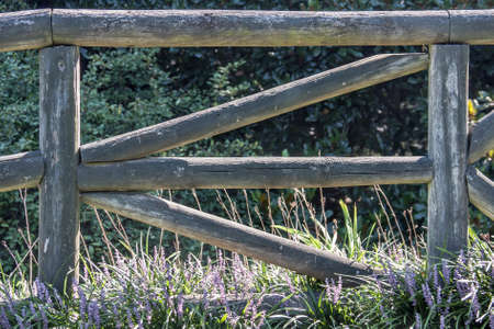 Letter E Formed by Rails in Wooden Fence photo