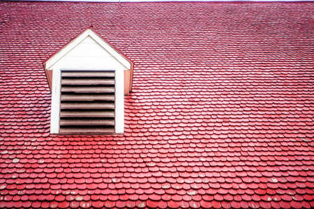 Red Wooden Tile Roof with Dormer photo