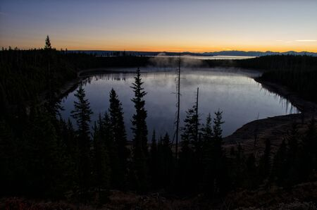 Yellowstone Lake at Sunrise with Mist rising from the Surface