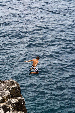 plunges: Boy plunges off a cliff very high