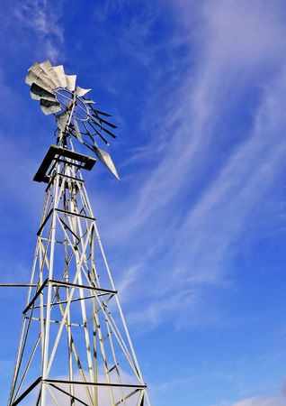 groundwater: Windmill against blue sky and clouds Stock Photo