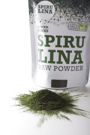 regimen: Spirulina raw powder on a white background