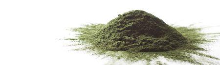 spirulina: Spirulina raw powder on a white background heap. Stock Photo