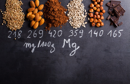 Products rich in magnesium on black background. Standard-Bild