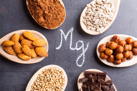 Products rich in magnesium on wooden spoons. Stock Photo