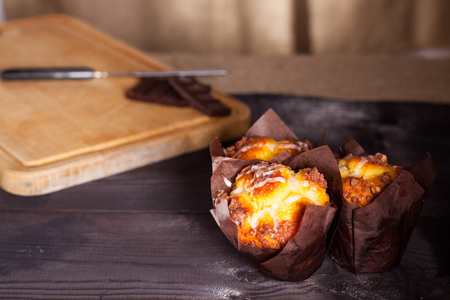flourless chocolate cake: Muffins with chocolate on wooden background. Stock Photo