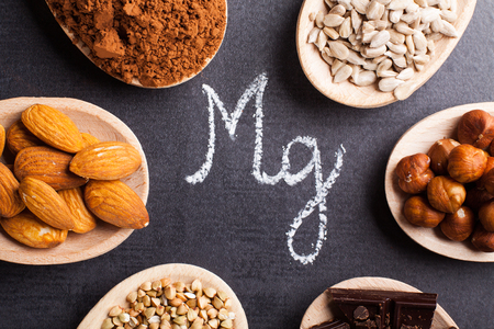 magnesium: Products rich in magnesium on wooden spoons. Stock Photo