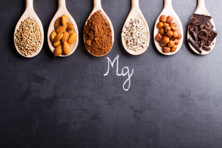 Products rich in magnesium on wooden spoons