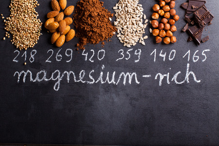 Products rich in magnesium on black background. Stock Photo