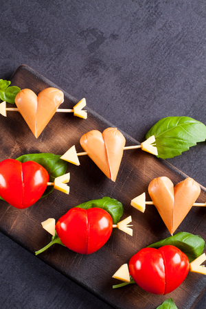 cocteles: Marinated fillet with tomato and sausage heart shaped.  Appetizer for a party. Valentines Day treat for your loved one.