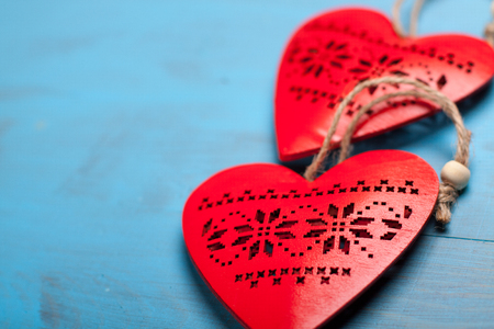 liaison: Red hearts on blue wooden background. Symbol of love in valentines day.