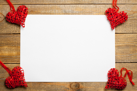 love affair: Blank sheet of paper on wooden background with heart.