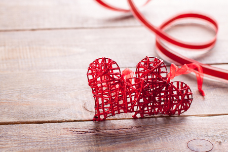 Red hearts on wooden background. Symbol of love in valentines day.