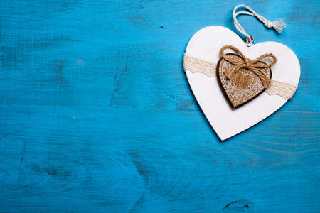 love affair: White heart on blue wooden background. Symbol of love in valentines day.