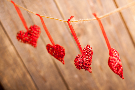 love affair: Red hearts on wooden background. Symbol of love in valentines day.