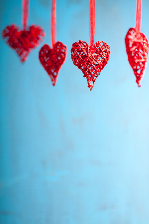 Red hearts on blue wooden background. Symbol of love in valentines day.