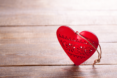 liaison: Red heart on wooden background. Symbol of love in valentines day.