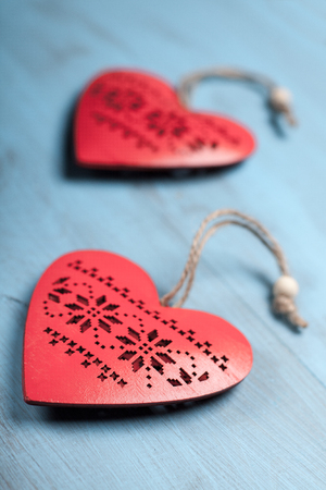 love affair: Red hearts on blue wooden background. Symbol of love in valentines day.