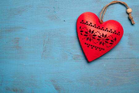 love affair: Red heart on blue wooden background. Symbol of love in valentines day.