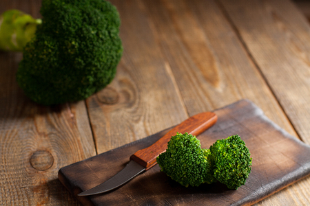 potherb: Raw green broccoli on wooden background