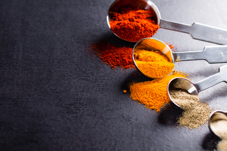 measuring spoons: Spices in stainless steel measuring spoons with copy space. Stock Photo