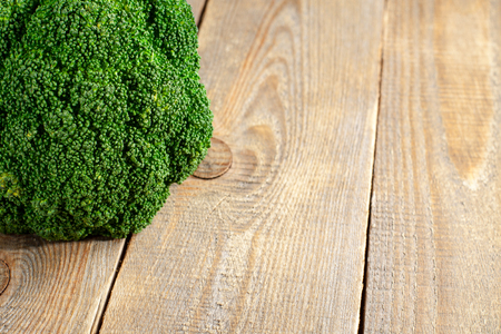 potherb: Raw broccoli on wooden background with copy space.