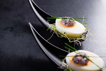 dapper: Appetizer on fingerspoon egg with caviar Stock Photo