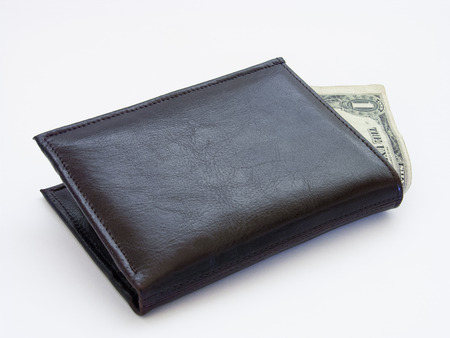 Closed wallet with sticking one dollar