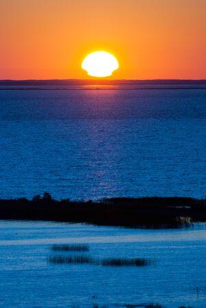 briny: Sunrise over the lake.