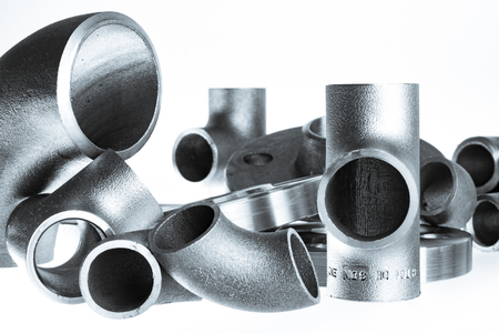 Steel welding fittings on group. Flanges, elbow, tees and plu on white space. Standard-Bild