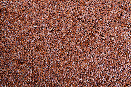 flaxseed: Wallpaper of flaxseed. Background of linseed. Stock Photo