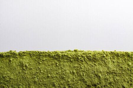 green powder: Frame of green powder superfoods on white. Stock Photo