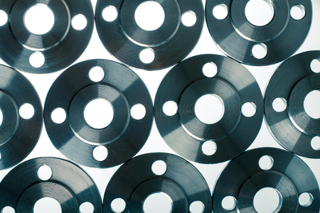 flange: Wallpaper of flat steel flange isolated on white. Stock Photo