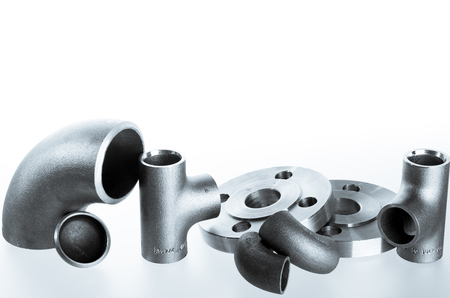 flanges: Steel welding fittings on group. Flanges, elbow, tees and plu on white space. Stock Photo