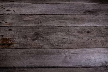 horizontally: Gray background of wooden planks arranged horizontally.