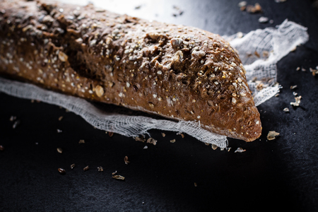 gauze: Multigrain baguette and scattered seeds, lies on a gauze