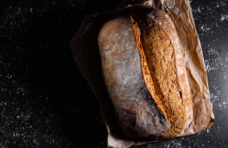 Fresh bread on a black background with copy space.