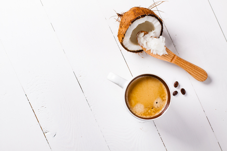 Bulletproof coffee, it's a coffee blended with butter or coconut oil. Wiev from above on coffee and coconut. Part of ketogenic diet, better choice before trainning.