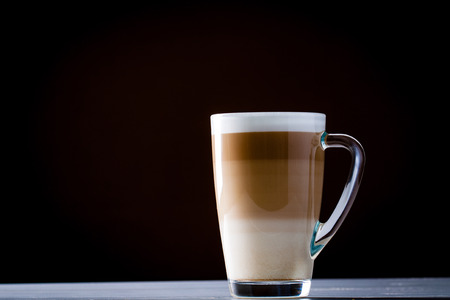 Original latte macchiato coffee in transparent glass. Stock Photo