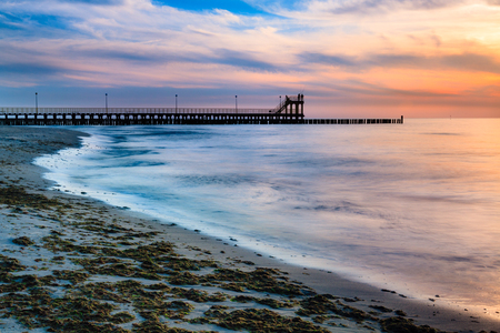 blurring: Coast with piles during sunset, long exposure blurring water.Baltic, Poland.