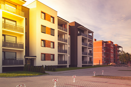 multifamily: New multi-family block with balconies and bright facade decorated with wood paneling.