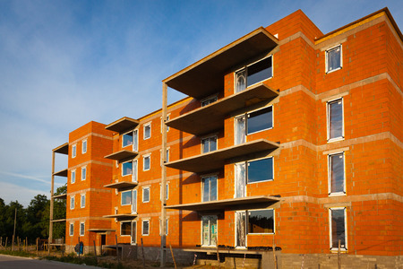 multifamily: Multifamily building under construction.