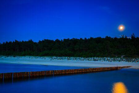 quay: Sea coast at night. Baltic Poland.